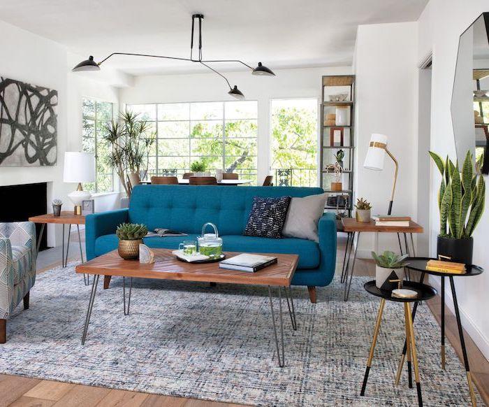 white-walls-mid-century-modern-living-room-blue-sofa-with-wooden-coffee-table-and-side-tables-blue-and-white-carpet-on-wooden-floor